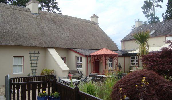 Bramley Apple Cottage views over courtyard garden